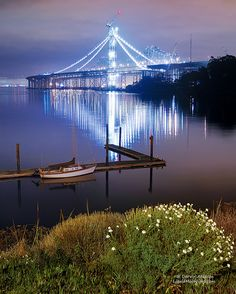 Judge Smails Yacht meets the new Oakland Bay Bridge by Darvin Atkeson, via Flickr