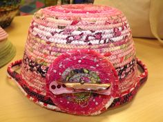 pink round clothesline basket with handles inverted front view