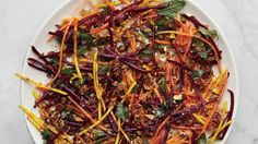 Carrot and Beet Slaw with Pistachios and Raisins Recipe | Bon Appetit