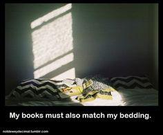 My books must also match my bedding. (notdeweydecimal.tumblr.com)