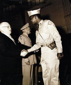 Korean War, Prisoners of War. Repatriated Prisoners of War upon their arrival at San Francisco, California, aboard USNS General Nelson M. Walker (AP 125). Second POW disembarking from ship is greeted by Mayor Robinson of San Francisco. Photographed August 23, 1953. U.S. Navy photograph, now in the collections of the National Archives.