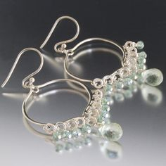 These earrings are wire wrapped by hand using sterling silver wire. They dangles are faceted green amethysts gemstones. The frame is solid sterling silver. Wonderful elegance. Total length is 2 inches. Great alternative to traditional Amethyst for February's birthstone