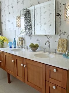 Double vanity sink with white marble, black and white patterned wallpaper and shower curtain | bd home design + interiors