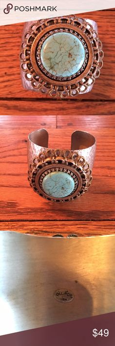 "Ollipop turquoise cuff bracelet Hammered metal, width 2"", adjusts to fit 6""-8"", turquoise is a deeper green than pic shows.  Gently worn a handful of times. Ollipop Accessories"