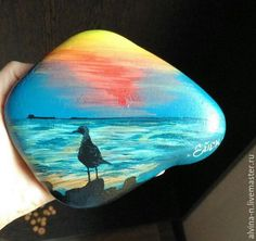 Serene seascape hand painted rock art on flagstone