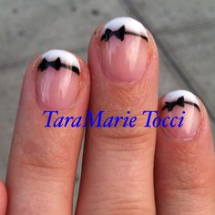 Alice in Wonderland nails. I would do light blue instead of the clear, on the bottom. Love the white tips with the black bow.