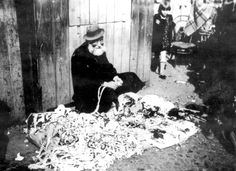 Lodz, Poland, A Jew selling strings and strips of cloth on a ghetto.