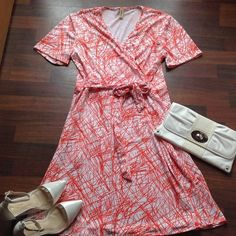 Dress 95%Polyester 5% Rayon faux wrap dress 1x fits 12/14 dress is orange and white Boutique Dresses