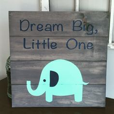 22x22 Elephant Nursery Sign, baby shower gift. This is a elephant sign for a nursery or children's room. This sign is handmade and hand painted by me. The colors are gray stained sign, mint elephant with a navy blue ear and navy blue lettering . I attach a sawtooth mount the back of the sign so you can easliy hang it on your wall.
