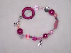Sue loaded this bracelet with gemstones, crystals, silver, shell, pearls and of course a breast cancer awareness charm to finish it. A portion of the proceeds from this bracelet will go to Canadian Breast Cancer Foundation. Thank you for helping support breast cancer awareness.