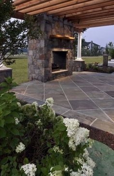 This out door fireplace on the patio makes me invision cool fall nights with good friends!