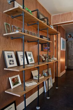 Metal pipe bookshelf-- at Poke Acupuncture - as seen on Design Sponge - Photographer: Bethany Nauert