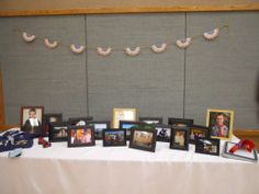 Table display of photos from cubscout to boyscout  Binder of Eagle Scout Project to display