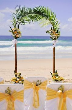 Pretty and simple arbor made from palm fronds. #beach #wedding