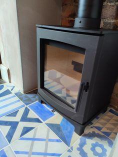 Gorgeous tiles under woodburner