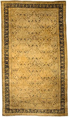 A Chinese carpet BB3749 - An early 20th century Chinese antique rug, the oatmeal field with a lattice formed of delicate vinery containing ...