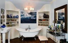 The master bath with claw foot slipper tub, dual sinks and walk-in marble steam shower at Notleymere Cottage in Cazenovia