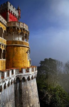 Pena National Palace in Sintra, Portugal - . The palace is a UNESCO World Heritage Site  one of the Seven Wonders of Portugal.  Photography by Santi at FotografiaUrbana on Flickr.