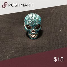 Blue Crystal Skull Ring NWOT stretchy ring. Really pretty crystal blue skull ring with moving jaw. Jewelry Rings