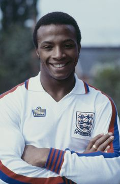 English professional footballer Cyrille Regis of West Bromwich Albion posed wearing an England national football team shirt, circa (Photo by Bob Thomas/Getty Images) England Football Players, England National Football Team, England Players, National Football Teams, Classic Football Shirts, Vintage Football Shirts, West Bromwich Albion Fc, Coventry City Fc, Football Kits