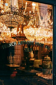 Beautiful storefront in Paris, full of chandeliers