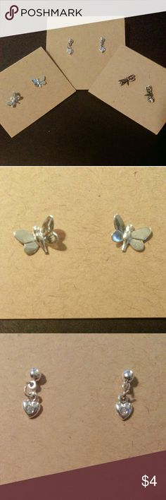 Dragonfly, butterfly, and heart earring set Set of three cute earrings! Heart with fake diamond in the middle, silver butterflies, and dark dragonflies with dark purple. Slight discoloration to backs, still good condition.   Like the earrings but not the whole set? Or want to pair them with another? Let's talk! Jewelry Earrings