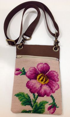This is a pretty, pink peony themed, vintage, needlepoint tapestry that I sewed into a zippered bag.  Actual bag measures approximately 5 3/4 x 8 1/2.  Zipper opening is approximately 4 3/4.