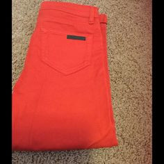 Prada red crop jeans Brand new it's just too tight for me, I took the tag off but never worn Prada Jeans Ankle & Cropped