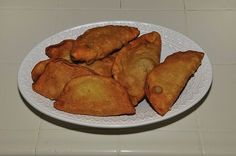 Fleischkuekle: Fleischkuekle is a type of meat pie made with dough, similar to a Cornish pasty, or Russian chebureki. The dish is traditional Volga Deutsche/Germans from Russia recipe, and through immigration became an addition to the Cuisine of North Dakota. It is also spelled Fleischkuechle. This dish is also popular among the many Russian-German immigrant families of  South Dakota.