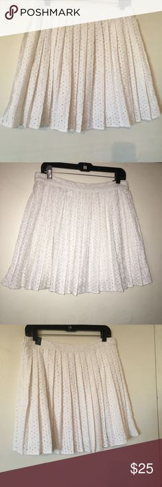 Abercrombie & Fitch eyelet skirt size large nwt Abercrombie & Fitch nwt white eyelet skirt. Has a white layer underneath. Skirt zips up size large Abercrombie & Fitch Skirts