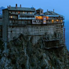 "Simonopetra, Athos, Greece. Simonopetra Monastery (Greek:  literally: ""Simon's Rock""), also Monastery of Simonos Petra is an Eastern Orthodox monastery in the monastic state of Mount Athos in Greece. Simonopetra ranks thirteenth in the hierarchy of the Athonite monasteries."