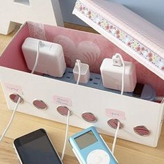 Cord organizer for a desk or charging station.