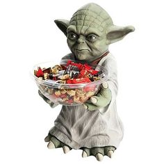 """Star Wars Yoda Candy Bowl Holder. Give your kitchen some Star Wars flair with the Star Wars Yoda Candy Bowl Holder! Featuring the diminutive but powerful Jedi master from the Star Wars movies in his instantly recognizable robe. Whether you're using this detailed guy as a decorative kitchen piece or as functional Halloween decor, you're going to love the Star Wars Yoda candy bowl holder! Size: 16"""" x 12"""" x 10"""" Price: 32.99"""