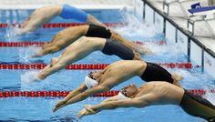 Swimmers start their heat in the men's 100-meter backstroke at the 2012 London Summer Olympics, Sunday, July 29, 2012 (AP Photo/Daniel Ochoa De Olza) (AP Photo/Daniel Ochoa De Olza)