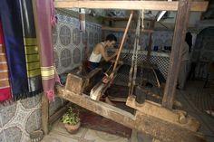 Man working a loom in a Medina workshop.