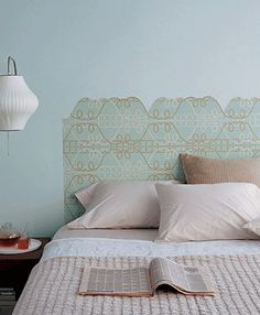 Using the lines in a graphic wallpaper as your guide, cut out a silhouette that serves as a virtual headboard