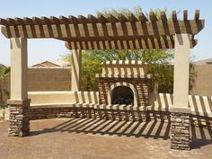 jarzemski-fireplace-arbor  Something like this out on the patio fir our table and chairs