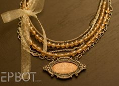 pressed-penny-necklace ~ I have a whole collection of pressed pennies. Now I know how to use them! :)