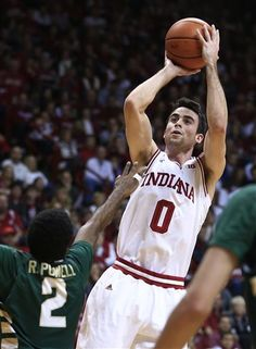 Indiana's Will Sheehey (0) puts up a shot against Jacksonville's Russell Powell during the second half of an NCAA college basketball game Friday, Dec. 28, 2012, in Bloomington, Ind. Indiana defeated Jacksonville 93-59. (AP Photo/Darron Cummings)