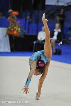 Did I say yet that rhythmic gymnastics is sooo cool! I men's look at that flexibility and strength!