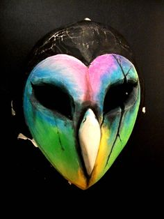 This owl is creepy, yes indeed. But with a face that colorful, I can't help but find it oh so cute!