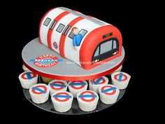 Underground Tube Train Cake & Cupcakes by Relznik, via Flickr