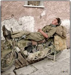 #WW2ColourisedPhotos ..... Trooper Albert Andre Coulombe H/100590 (aged 20) from Benard, Manitoba, Canada of the 14th Armoured Regiment (The Calgary Regiment), resting on his Norton 16H motorcycle in Volturara, Italy. 3 October 1943. Sadly, he was killed at Monte Cassino, May 12 1944 and lies at the Cassino War Cemetery, Cassion in the Province of Frosinone, 139 kms from Rome.