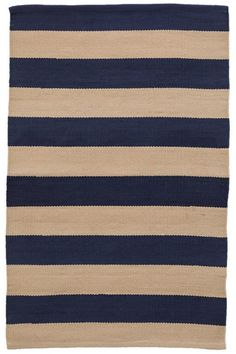 """Say """"Hello!"""" to the Catamaran Stripe Navy/Khaki Indoor/Outdoor Rug. The preppy stripes of this beach cottage rug accentuate any space in your home."""