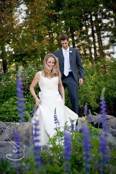 Lake Tahoe Wedding  bride and groom with purple Lupines  © PhotographybyMonique.com