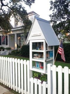 Nicole Larrieviere. Mobile, AL. We live in a charming historic area of Mobile, Alabama called Dauphin Way Historic District. There are beautiful Oak lined streets and sidewalks where people ride their bikes, run, walk, visit with neighbors and share books. Repurposed windows were used to create a quaint library. The design is coastal cottage inspired and includes the classic southern porch blue ceiling paint inside. A variety of books may be found inside!