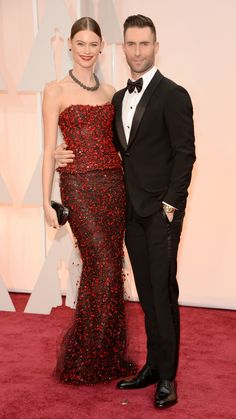 Singer Adam Levine and Behati Prinsloo wearing Armani Prive walk the 87th Annual Academy Awards red carpet. via @stylelist   http://aol.it/1w0nfry