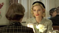 Rooney Mara and Cate Blanchett (right) begin a love affair after meeting in a department store in Carol.