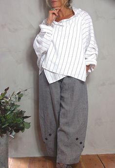 Tokyo Top in white striped linen, £225, (also grey and navy) over Penny Trousers in linen, £225.