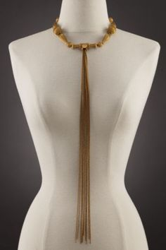 Matte gold beaded choker with a  long tassel that flows to the waist.